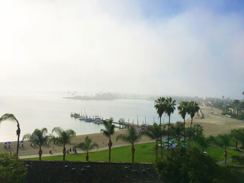 View of beach and grounds of Catamaran Resort in San Diego