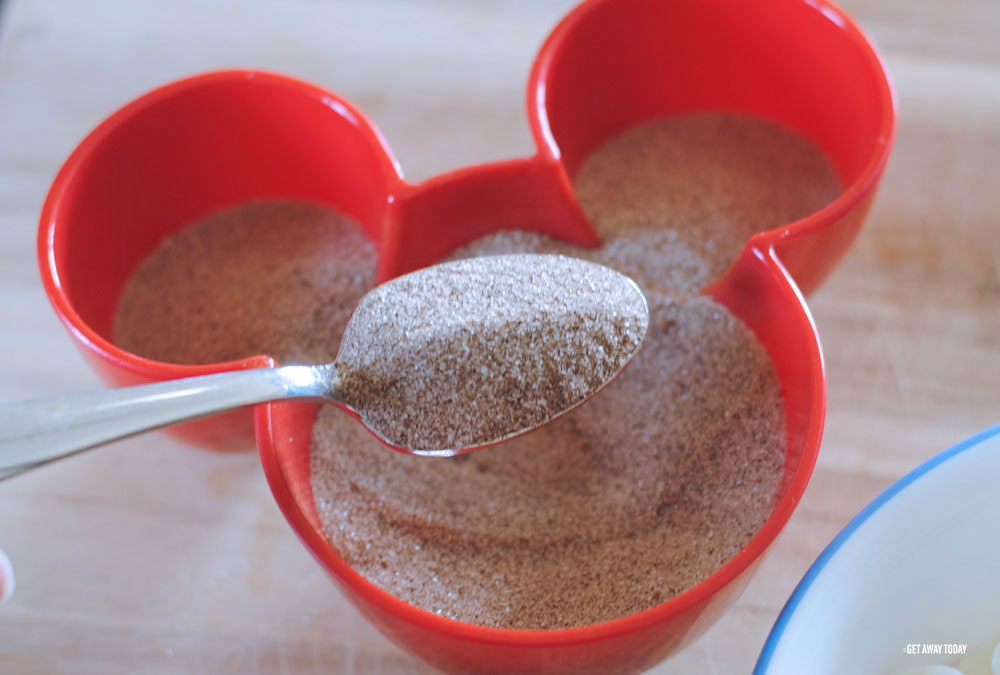spoonful of cinnamon and sugar in red Micky Mouse bowl