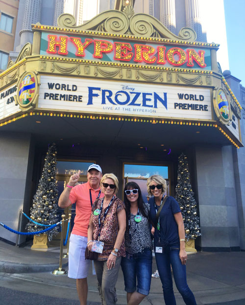 Group in front of Frozen Live at the Hyperion Sign