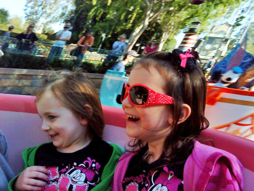 Girls laughing and spinning in TeaCups at Disneyland