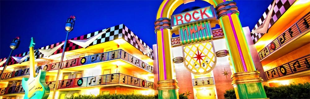 Disneys All Star Music Resort Exterior with bright and colorful lights