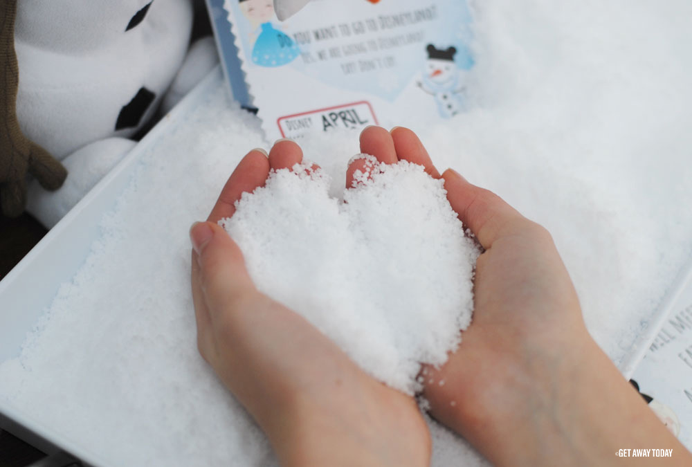 fluffy snow in hands