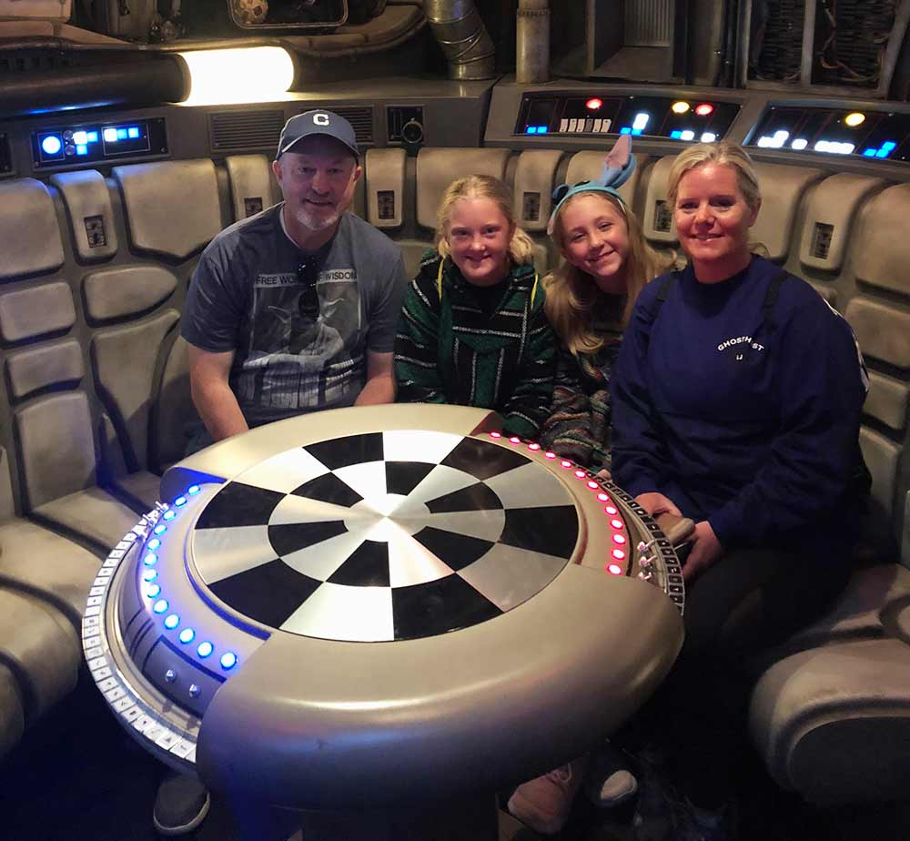 Family in millennium falcon chess board