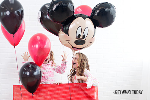 Girls opening We're going to Disneyland Mickey balloon surprise