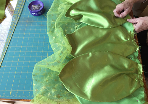 Sew the three layers together with a straight stitch about 1/2 inch from the top edge. I added an extra zig zag stitch across the top edge to help prevent ... & DIY Tinkerbell Costume for Adults