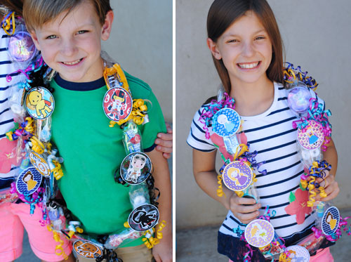Kids wearing vacation necklaces